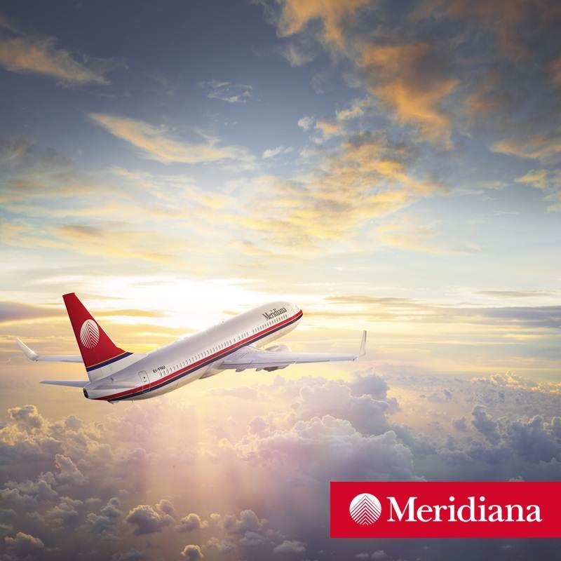 Aeronave da companhia aérea Meridiana em voo